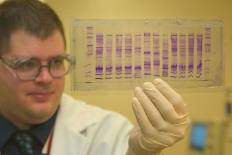 1024px-CBP_chemist_reads_a_DNA_profile